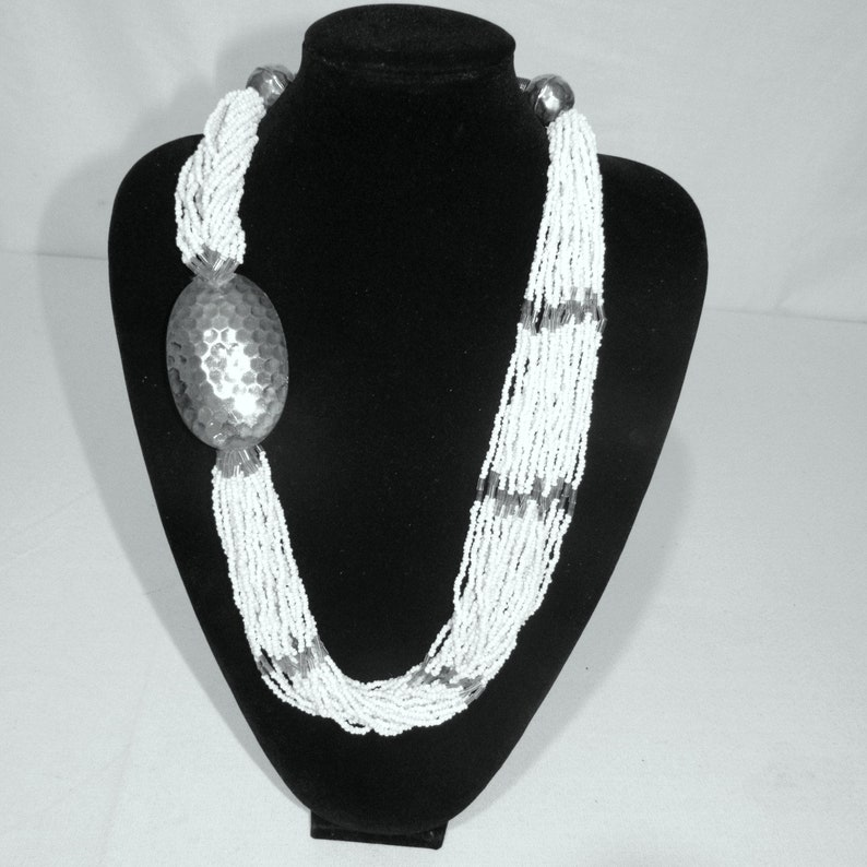 Vintage Statement Necklace 25 Strand White Glass Beads with a Silver Hammered Spinner