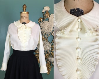 1970s blouse, jabot collar, accordion pleat, vintage 70s blouse, ruffled neckline, size medium, ball buttons, pale yellow polyester, 36 bust