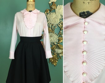 1970s blouse, jabot collar, accordion pleat, vintage 70s blouse, ruffled neckline, size medium, ball buttons, pale pink polyester, 36 bust