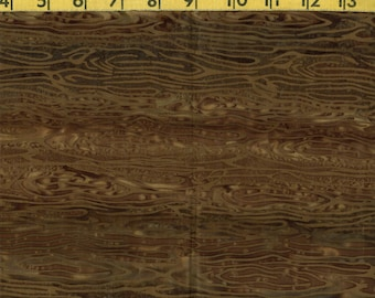 Batik fabric with wood grain print,  olive drab and brown tie dyed