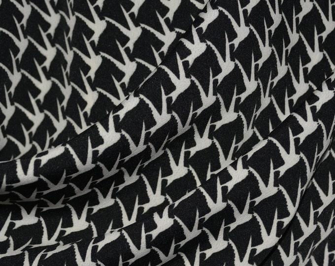 Black and cream swallow birds fabric, MC Escher style, fluid polyester print