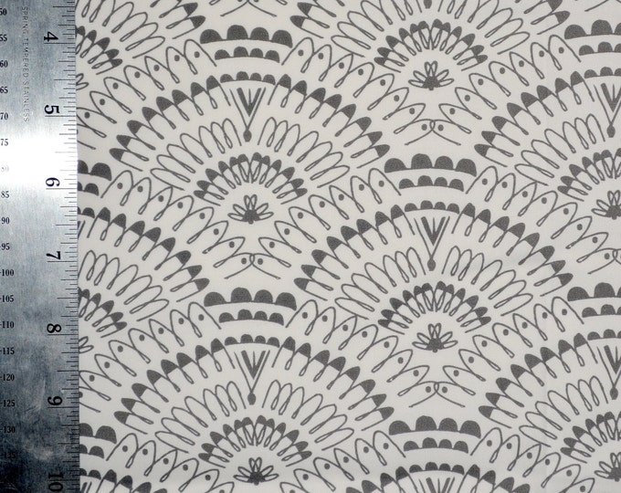 Grey white fabric, fan shapes scallops, repeating patterns, squiggly lines