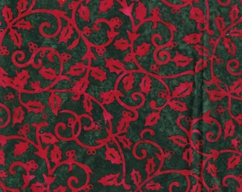 Christmas batik fabric, evergreen and red holly leaves