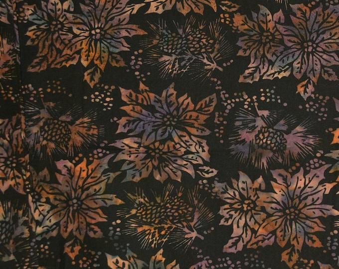 Earth tones Christmas fabric, batik pine cones and poinsettias on black, 100 % cotton
