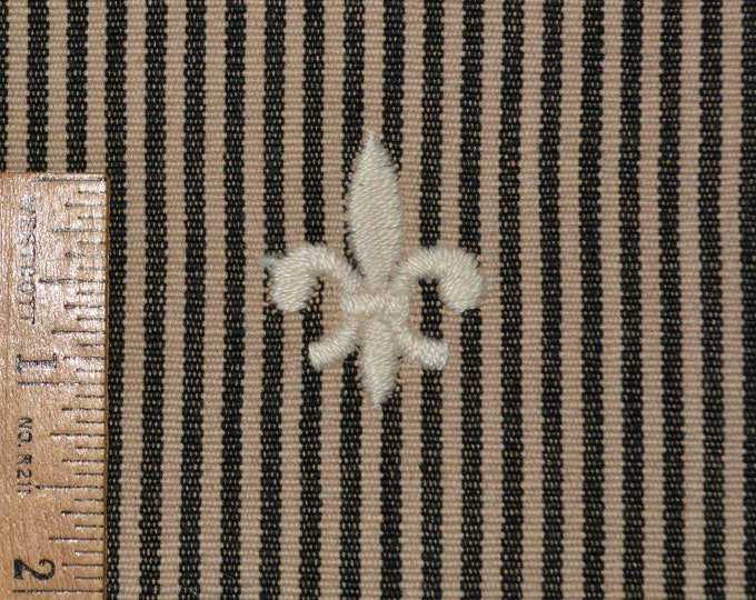 Upholstery fabric with fleur de lis