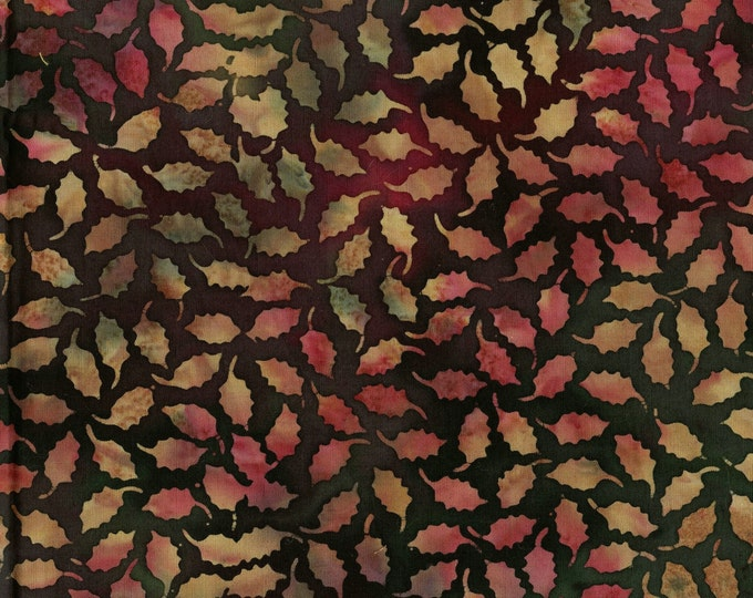 Earthy red and green holly leaves fabric, Tie dyed batik