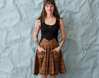 Summer's Plaid circle skirt. Two generous side pockets and a tall stretchy waistband for function and comfort. Fit and flare flowy skirt.