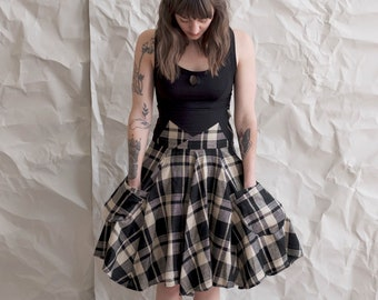Plaid skirt with 2 pockets. Fit and flare flowy skirt--midweight and draped. Tall stretchy waistband for a flattering fit. Made to order.