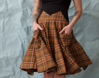 Plaid skirt with 2 pockets. Fit and flare flowy skirt--colorful plaid pattern. Tall stretchy waistband for a flattering fit. Made to order.