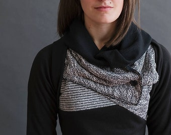 Black and grey cowl neck sweater with elbow patches and thumbhole sleeves. Asymmetric color block detail with stripes and cozy thermal knit.