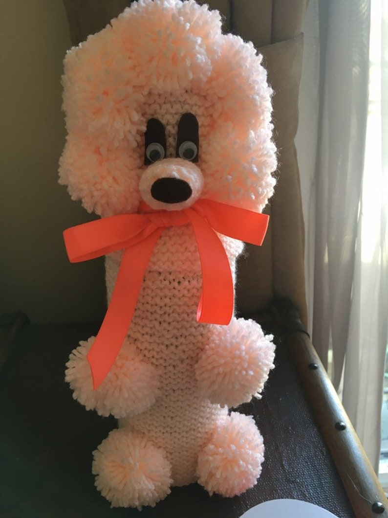 Gabrielle the GinPoodle bottle cosy in soft peach with a bright coral bow