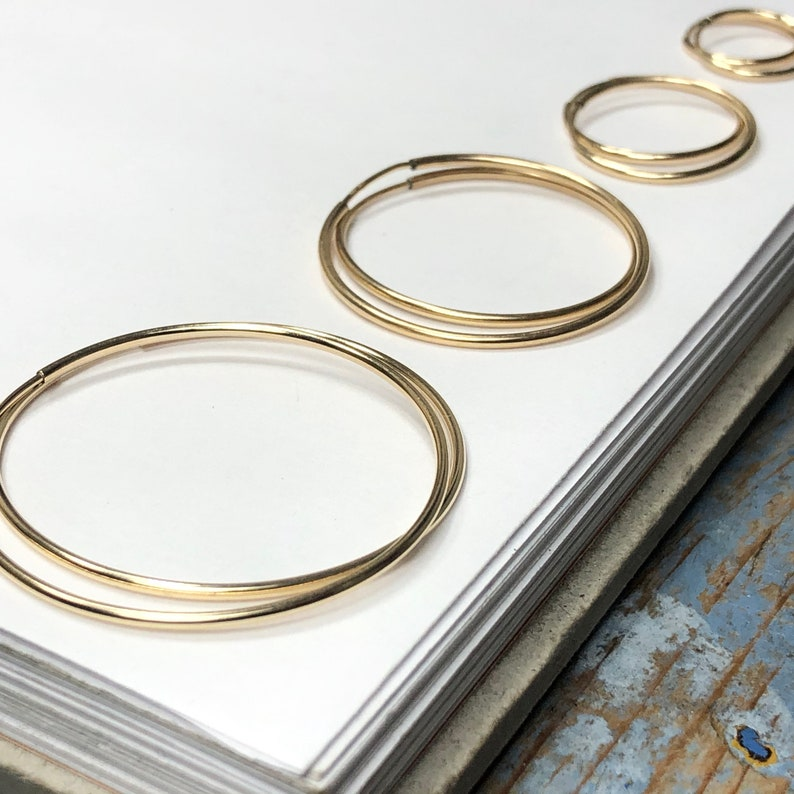 Gold Hoops  14k gold-filled infinity sleeper hoops in 6 sizes image 0