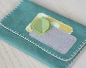 leafy felt wallet, teal with green leaves.