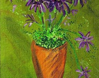 Purple Flowers in Orange Vase