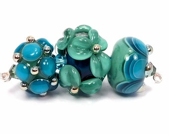 Bright teal, soft green and metallic handmade lampwork beads, floral, small glass bead set for jewelry making, by Kandice Seeber