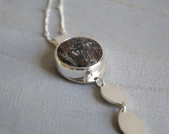 Redwood, a Petrified Dinosaur Bone and silver necklace