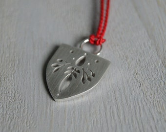 Bounty, a silver silhouette pendant, cut and pierced, argentium silver, silk, red, wedge