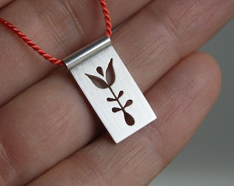 Tulip,a silver silhouette pendant, cut and pierced, argentium silver, silk, coral
