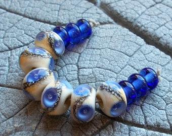 MTO Hummingbird Lampwork Bead with gold Spacers