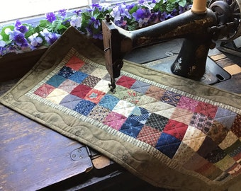 Patchwork  table topper in civil war colors