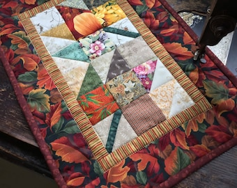 Autum Maple leaf wall or table decoration /Quilted maple leaf design in fall colors of brown golds reds and greens/Mini quilt