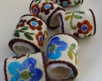 Set of 6 Fabric Beads Linen beads decorated with blue and brown embroidered flowers.