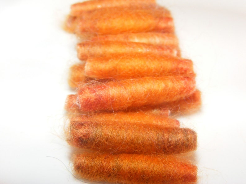 We said She went to cook some carrots and then she made us with orange roving Fiber Bead tube artisan bead make us soft and tender
