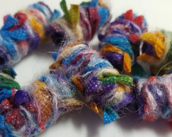 Set of 8 fabric beads. She made us and we love it that she keeps us in the loop. Loops. Many loops. Fiber Beads,wide hole, barrel tube bhb