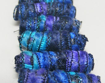 Set of 7 fabric beads. We have noticed the luxuriance and richness of the bead locks on some of our friends.We want that.Fiber Bead tube