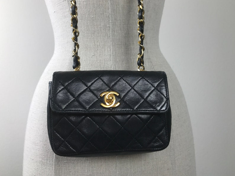 00f8b0b5fb0ab4 Vintage 90s Chanel black quilted Lambskin mini flap cross body | Etsy