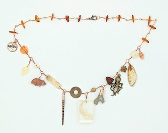 Curio Cabinet on a Charm Necklace with Rat Jaw Resin Centerpiece and Amber beads