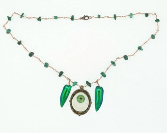 Green Prosthetic Eye Necklace with Jewel Beetle Wings and Malachite Beads