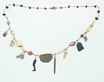 Curio Cabinet on a Charm Necklace with Bivalve Fossil Centerpiece and Garnet Beads