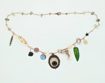 Curio Cabinet on a Charm Necklace with Brown Prosthetic eye Centerpiece and Prehnite Beads