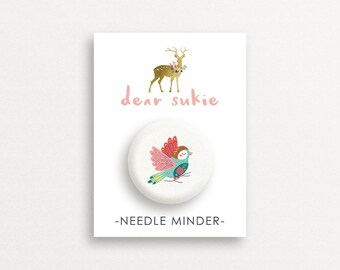 Needle Minders