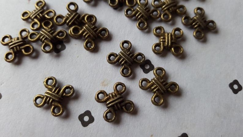 80pcs Antiqued Bronze Knot link connector