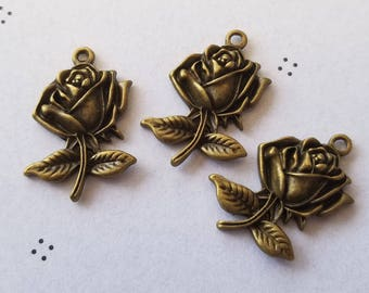 Antiqued bronze roses charms (3)