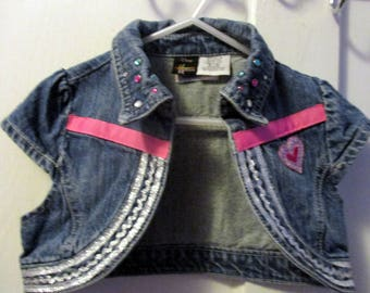 Upcycled and embellished denim vest for girls