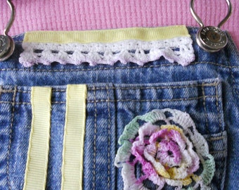 Upcycled and embellished denim overalls for girls.