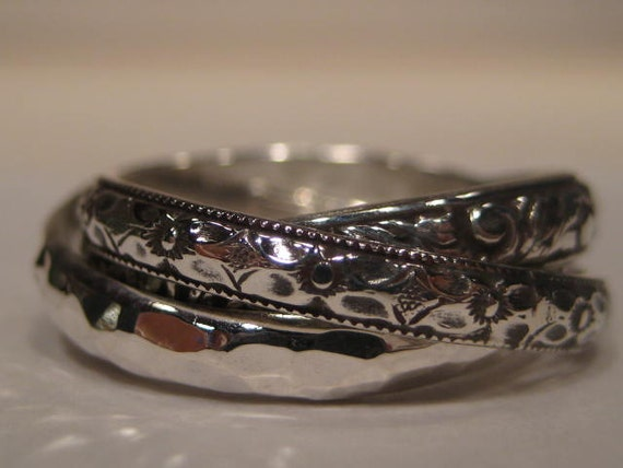 3 band Rolling Ring     One Antique Band   One Hand Hammered Band   One New  Leaf Band   Rolling Ring     Sterling Silver     COOL!