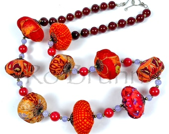 Rich Red fabric and beaded necklace in reds, orange and lavender