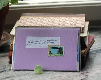 It is better to be sorry and stay, than to be sorry and go away. Lilac card with handwritten quote and Swedish postal stamp