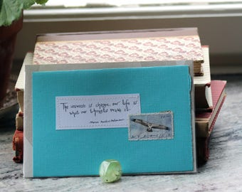 The universe is change; our life is what our thoughts make it.  Mint green card with handwritten quote and Swedish osprey postal stamp