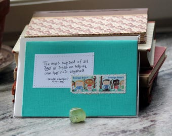 The most wasted of all days is that on which one has not laughed. Dark mint green card with handwritten quote and Swedish postal stamps
