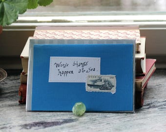 Worse things happen at sea ... Blue card with handwritten quote and Swedish ship postal stamp