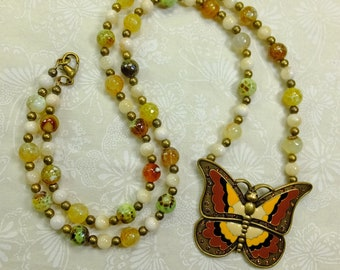 Enameled Yellow and Brown Butterfly Pendant on a Necklace of Agate, Calcite and Brass Beads