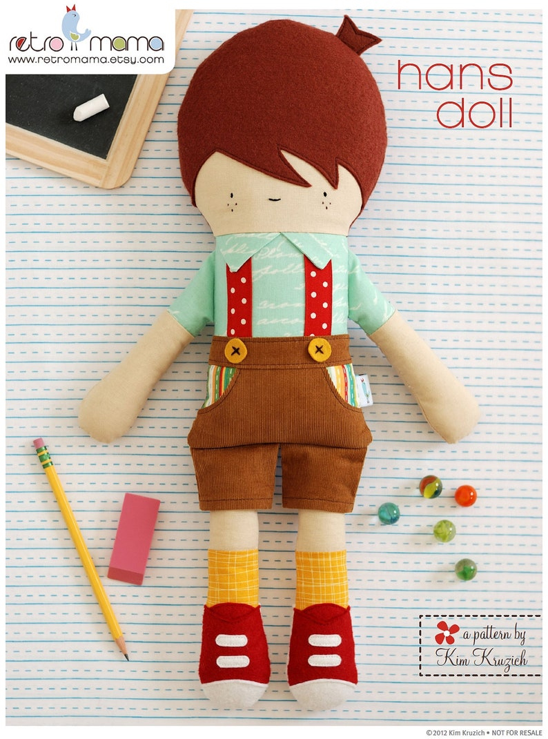 Hans from Retromama is a handsome boy doll wearing cute overalls.