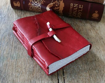 Leather Journal . scarlet red leather with natural shell peg . handmade handbound (320 pgs)