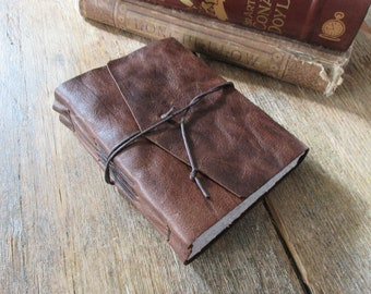 """Leather Travel Journal - J.R.R. Tolkien: """"Not all those who wander are lost"""" . handmade handbound . distressed dark brown (320 pgs)"""