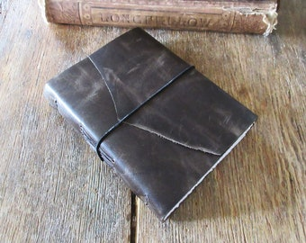 """Leather Journal . Jack Kerouac: """"One day I will find the right words, and they will be simple."""" dark distressed moss . handbound (320 pgs)"""